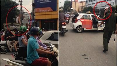 Tài xế taxi leo lên nóc xe 'ăn vạ' khi bị cảnh sát dừng xe