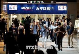Nhật Bản điều chỉnh mức tăng GDP