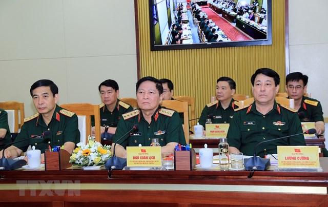 Đại tướng Ngô Xuân Lịch, Ủy viên Bộ Chính trị, Phó Bí thư Quân ủy Trung ương, Bộ trưởng Bộ Quốc phòng (giữa) chủ trì Hội nghị. Ảnh: TTXVN.