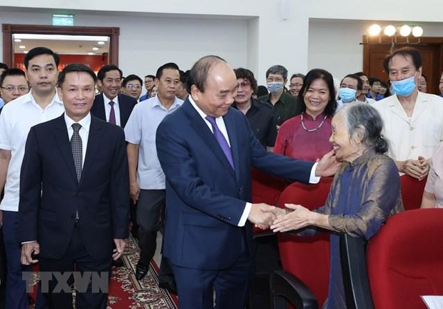 [ẢNH]Thủ tướng Nguyễn Xuân Phúc dự Lễ kỷ niệm 75 năm Ngày thành lập TTXVN - Ảnh 13