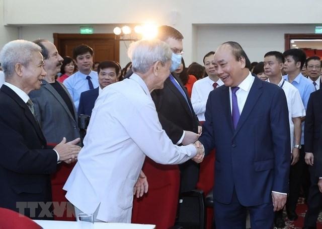 [ẢNH]Thủ tướng Nguyễn Xuân Phúc dự Lễ kỷ niệm 75 năm Ngày thành lập TTXVN - Ảnh 15