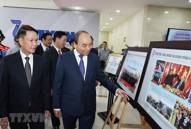 [ẢNH]Thủ tướng Nguyễn Xuân Phúc dự Lễ kỷ niệm 75 năm Ngày thành lập TTXVN - Ảnh 4