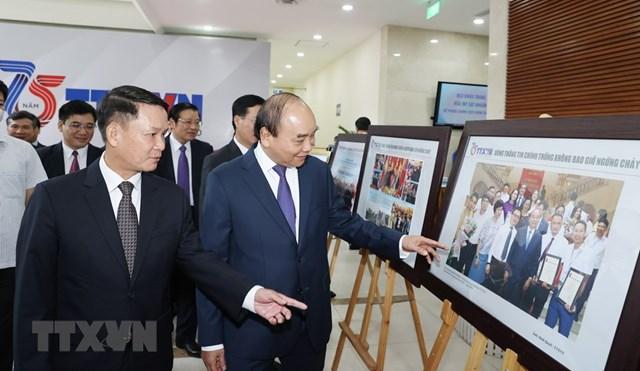 [ẢNH]Thủ tướng Nguyễn Xuân Phúc dự Lễ kỷ niệm 75 năm Ngày thành lập TTXVN - Ảnh 6