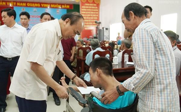 Thủ tướng dự chương trình 'Tết sum vầy' với người nghèo tại Vĩnh Long - 2