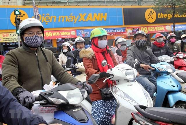 [ẢNH] Cuộc sống của người dân Hà Nội trong đợt rét đậm cuối năm - 10