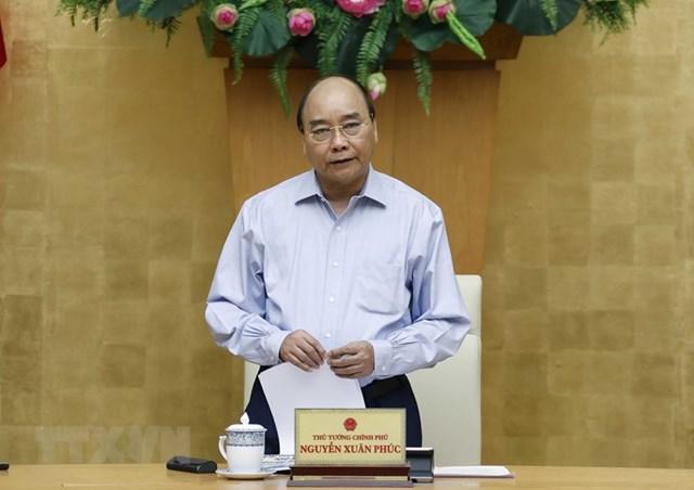 Thủ tướng Nguyễn Xuân Phúc phát biểu chủ trì cuộc họp về công tác phòng, chống dịch Covid-19. (Ảnh: TTXVN).