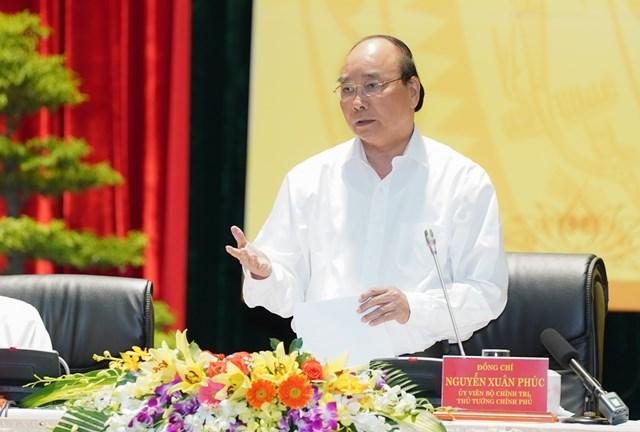 Thủ tướng Nguyễn Xuân Phúc phát biểu kết luận Hội nghị.Ảnh: VGP/Quang Hiếu