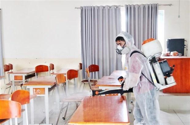 Khử khuẩn các điểm thi tốt nghiệp Trung học phổ thông. (Ảnh minh họa: Thu Hương/TTXVN).