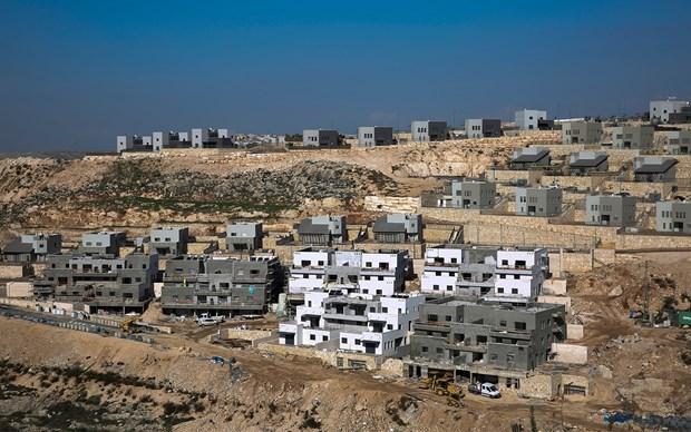Israel tạm dừng tuyên bố chủ quyền ở các khu định cư Bờ Tây. (Ảnh: AP).