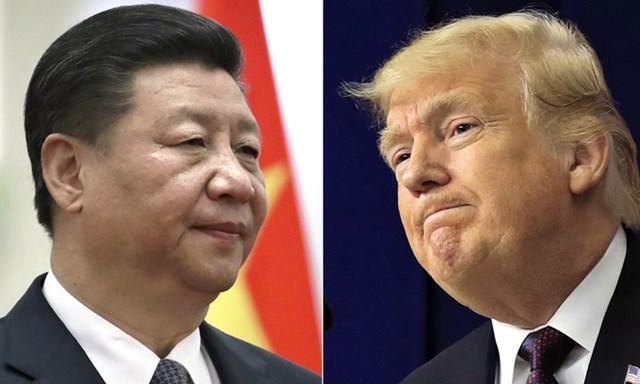 Chủ tịch Trung Quốc Tập Cận Bình (trái) và Tổng thống Mỹ Donald Trump. Ảnh: AP.
