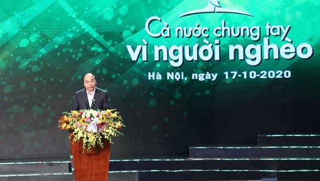 """Thủ tướng Chính phủ Nguyễn Xuân Phúc phát biểu tại Chương trình""""Cả nước chung tay Vì người nghèo"""" năm 2020. Ảnh: Quang Vinh."""